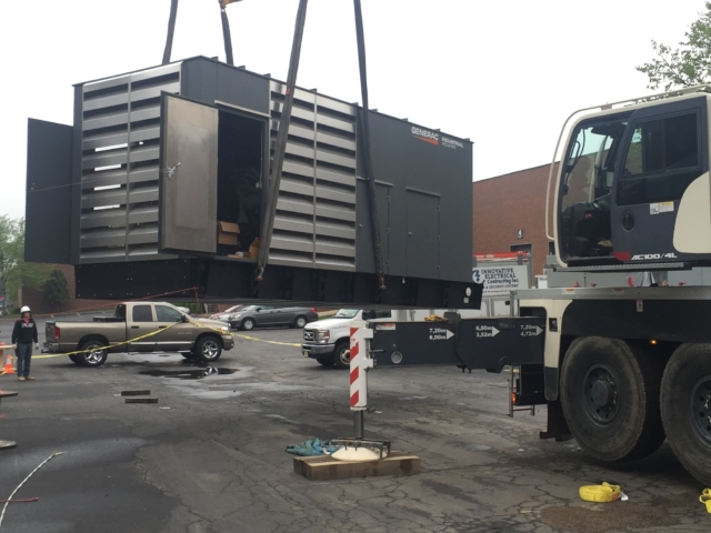 Setting the 1 Meg ( 1000kw ) Generac Generator in place with a BIG crane - Fairfield, NJ
